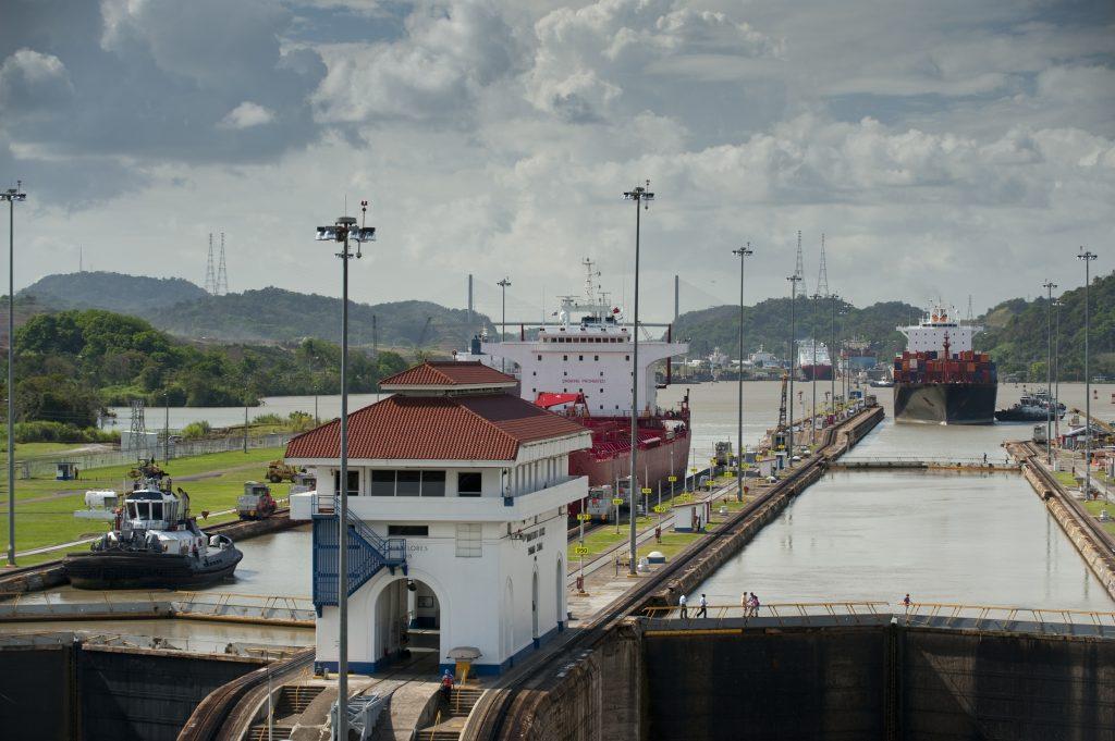 Cargo ships arriving to Miraflores Locks. Panama Canal, Panama City, Panama, Central America.