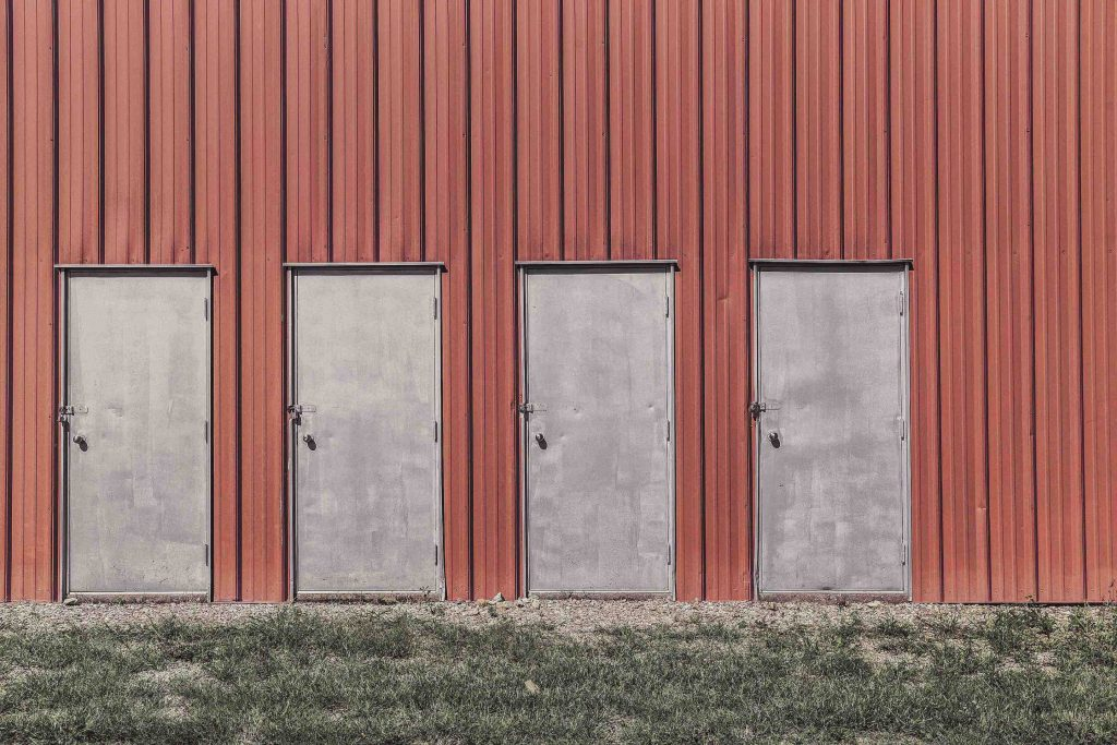 Four doors of a warehouse next to each other