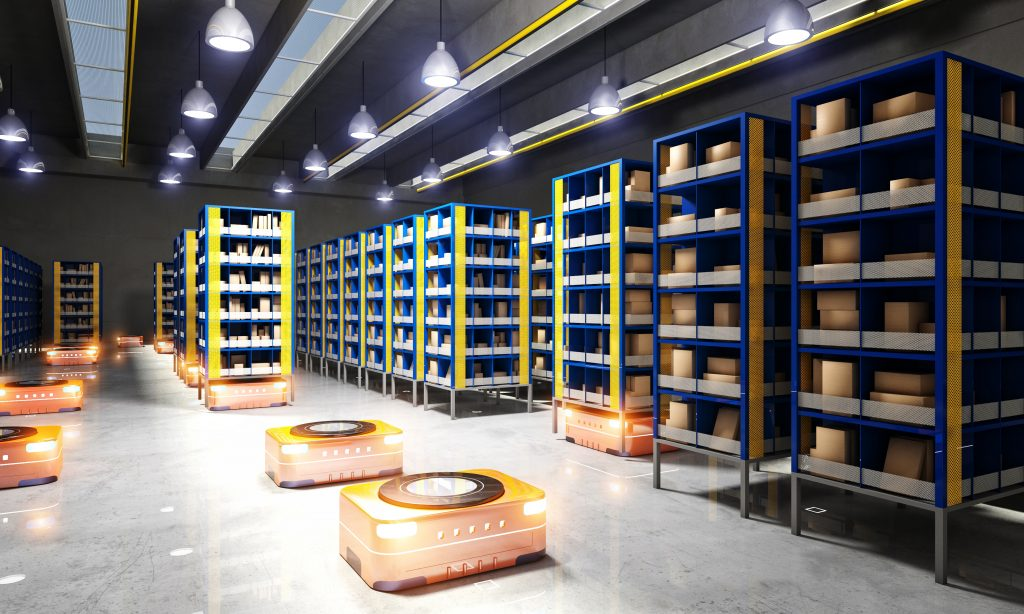 Robots move around an autonomous warehouse space with racks