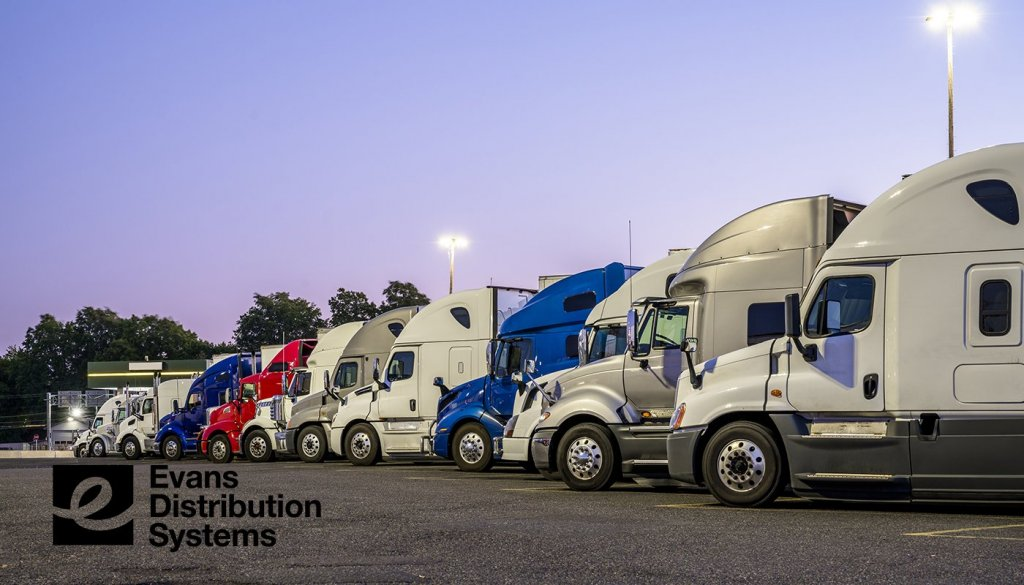 ATA Trucking Tonnage Index image. A line of trucks parked in a row.